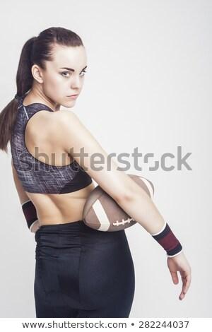 Portrait of serious female athlete holding rugby ball Stock photo © wavebreak_media
