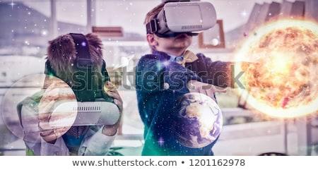 Ragazzo business executive virtuale realtà auricolare Foto d'archivio © wavebreak_media