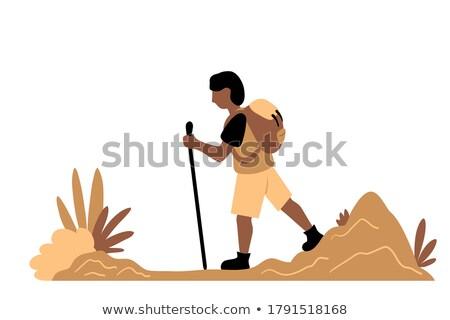 Young african hiker walking with trekking sticks. Stock photo © RAStudio