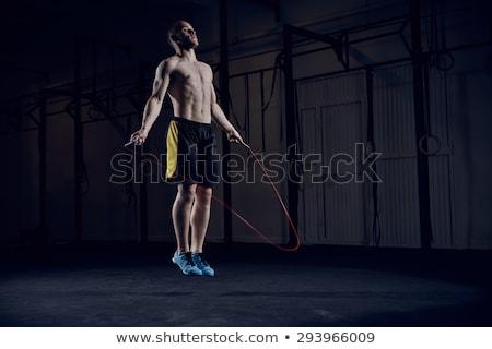 Gömleksiz adam atlama halat crossfit spor salonu Stok fotoğraf © wavebreak_media