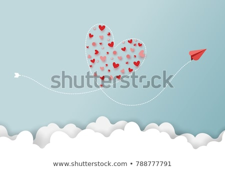 Retro airplane flying in the clouds. Air travel background Stock photo © studiostoks