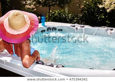 Vrouw hot tub leuk vrijheid eiland zonnebril Stockfoto © IS2