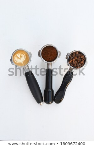 Metal Italian coffee maker with coffee beans in the form of a po Stock photo © artjazz
