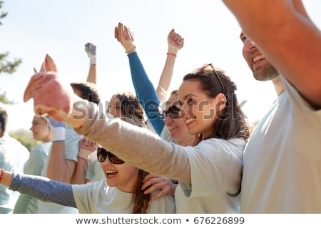 Groupe bénévoles célébrer succès parc bénévolat Photo stock © dolgachov