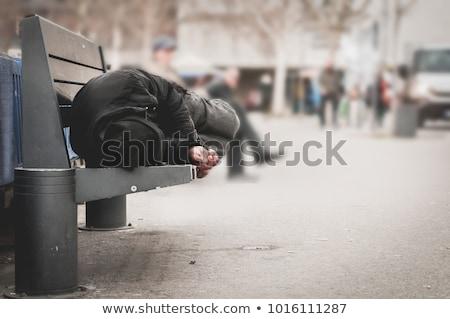young woman sleeping on a bench homeless stock photo © studiostoks