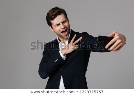 Immagine felice imprenditore 30s formale suit Foto d'archivio © deandrobot
