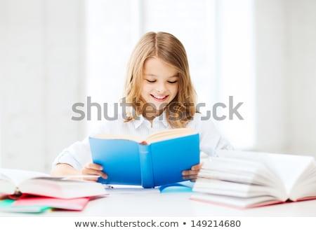 student · blond · meisje · schrijven · huiswerk · vrouw - stockfoto © andreypopov