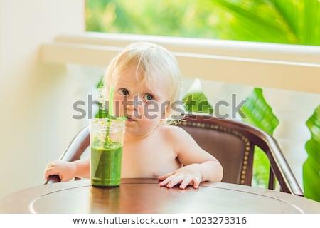 Criança menino potável saudável verde vegetal Foto stock © galitskaya