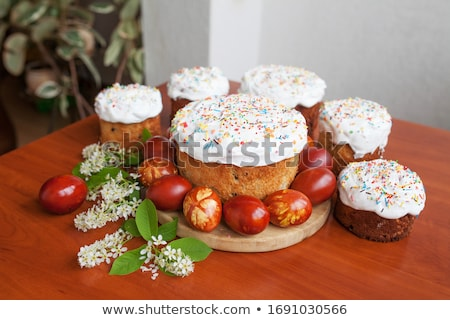Easter orthodox sweet bread, kulich and colorful quail eggs Сток-фото © Melnyk