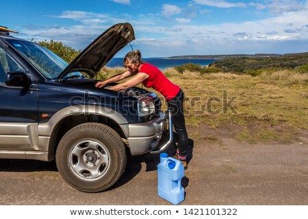 Woman fixing her broken down car 4wd Stock photo © lovleah