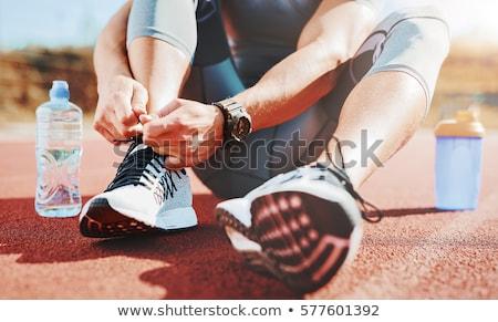 Sportok tevékenység fiatal izzadt izmos atléta Stock fotó © pressmaster