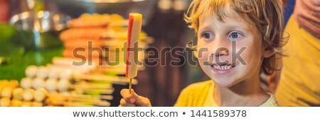 boy tourist on walking street asian food market banner long format stock fotó © galitskaya