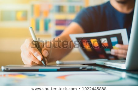 Hands of young creative designer with swatches Stock photo © pressmaster