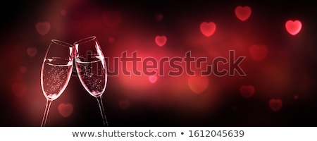 two champagne glasses framed by red heart shape Stock photo © dolgachov
