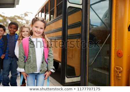 Three girls in front of school waiting for the bus Stock photo © Kzenon