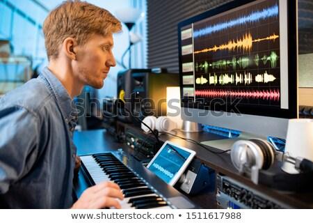 Sérieux homme toucher une touches regarder Photo stock © pressmaster