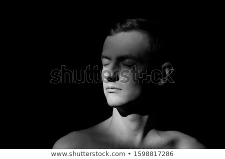 Black and white profile portrait of attractive man, low key. Stock photo © lichtmeister