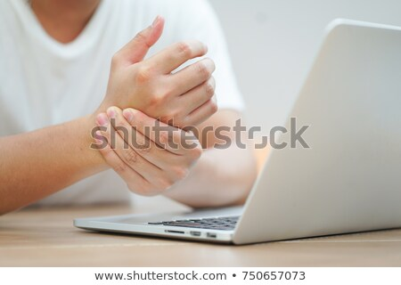 Businessman Holding Painful Wrist At Office Desk Stock photo © AndreyPopov