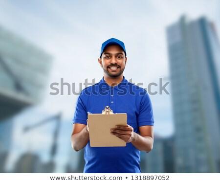 Feliz indio mensajero portapapeles ciudad mail Foto stock © dolgachov