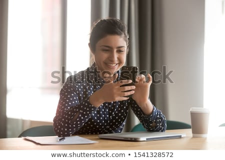 pretty student or businesswoman in smart casual using mobile gadgets stock photo © pressmaster
