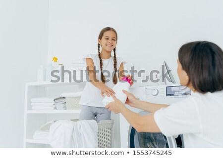 Derűs lány mosás mosószer anya szennyes Stock fotó © vkstudio