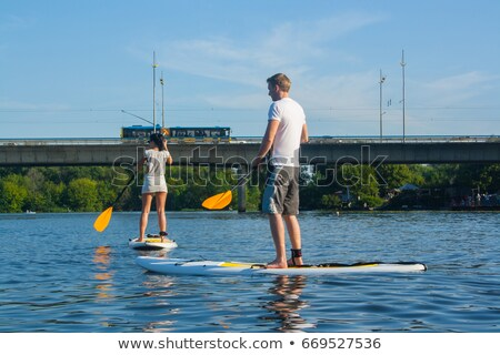 Man on a stand up padlle board on a lake Stock photo © lightpoet