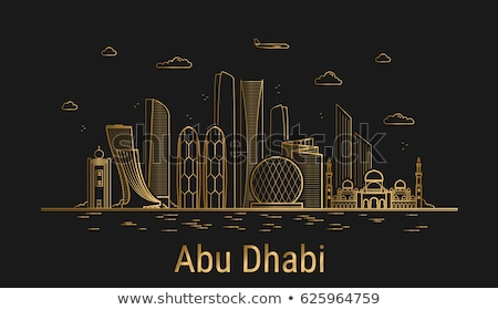 Abu Dhabi City skyline golden silhouette. Stock photo © ShustrikS
