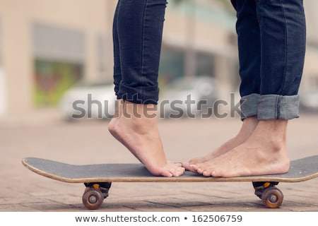 close up of young couple with skateboards in city Stock photo © dolgachov