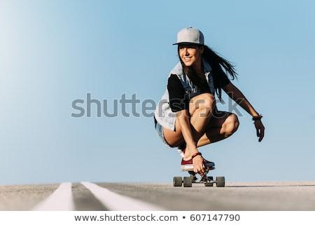 Genç kız binicilik kaykay şehir sokak yaz doğa sporları Stok fotoğraf © dolgachov