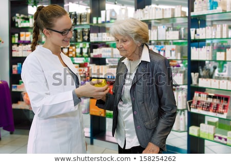 Stock fotó: Apothecary And Woman With Drug At Pharmacy