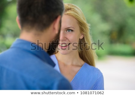 Attractive woman adored by men Stock photo © konradbak