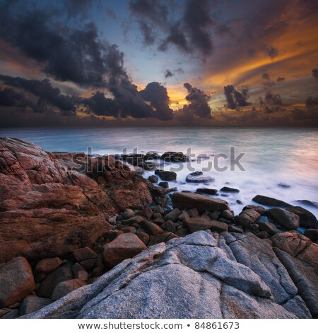 Foto d'archivio: View Of A Rocky Coast At Sunset Ultra Wide Angle Long Exposure