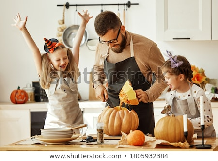 father and daughter carving pumpkins stock photo © photography33