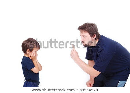 ストックフォト: A Father Is Threatening His Little Boy With A Finger