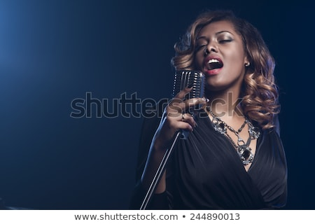 Zdjęcia stock: Beautiful Black Singer On Stage With Microphone