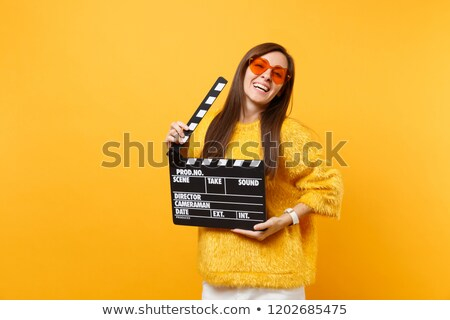 stylish woman with a movie clap board Stock photo © photography33