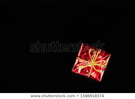 Foto d'archivio: Red Paper In Black Background