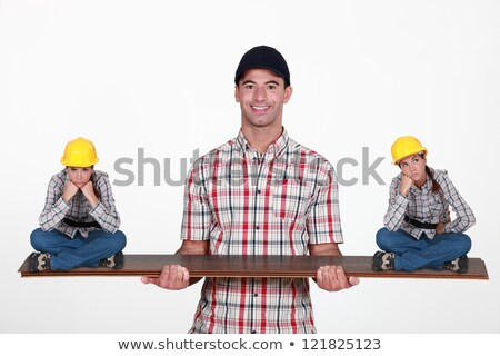 Construction manager balancing disgruntled staff Stock photo © photography33