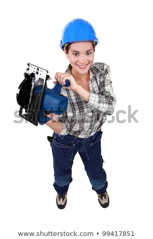Tradeswoman holding a saw Stock photo © photography33