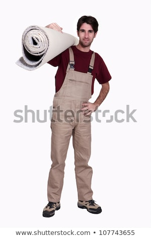 Carpet fitter carrying a roll of carpet Stock photo © photography33