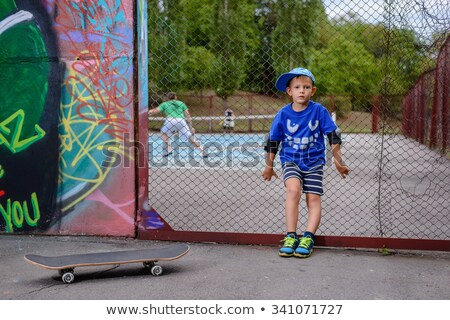 Tennis player leaning against fence stock photo © photography33