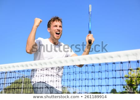 Smiling tennis player standing outside a hard court stock photo © photography33