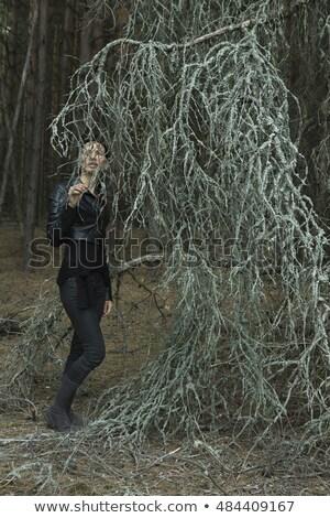 Woman Walking In Savage Garden Stock photo © adamr