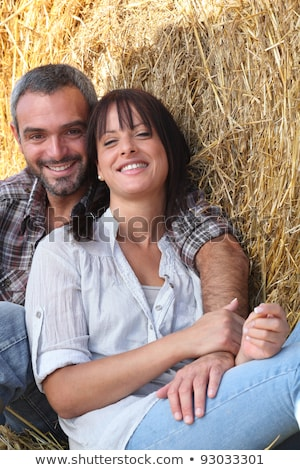couple of farmers all smiles posing in barn Stock photo © photography33