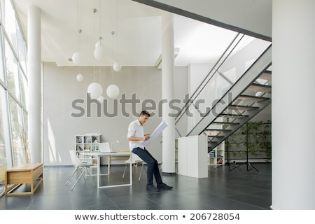 businessman holding a blueprint Stock photo © photography33