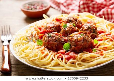 Spagetti húsgombócok tányér hús paradicsom ebéd Stock fotó © M-studio