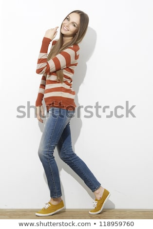 woman in 30s in top with stripes and jeans Stock photo © lubavnel