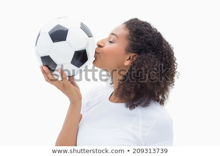 young beautiful woman about to kiss a football Stock photo © Rob_Stark