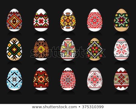 Paskalya el boyama paskalya yumurtası kadın eller Stok fotoğraf © saje
