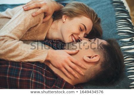 Meghitt fiatal pér előjáték ágy szex pár Stock fotó © bartekwardziak